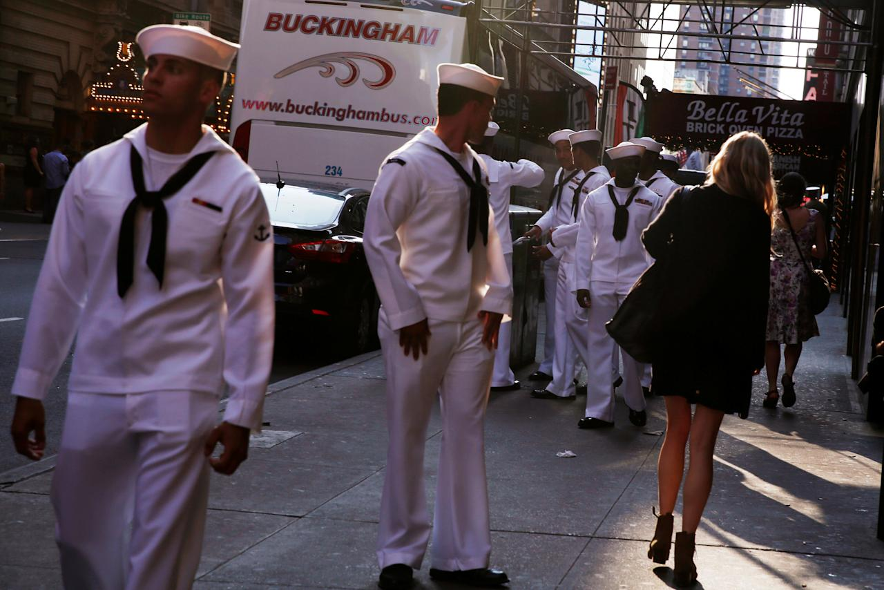 U.S. Navy sailors watch a woman walk past as they walk through Times Square during Fleet Week in New York, U.S., May 25, 2016. REUTERS/Lucas Jackson     TPX IMAGES OF THE DAY