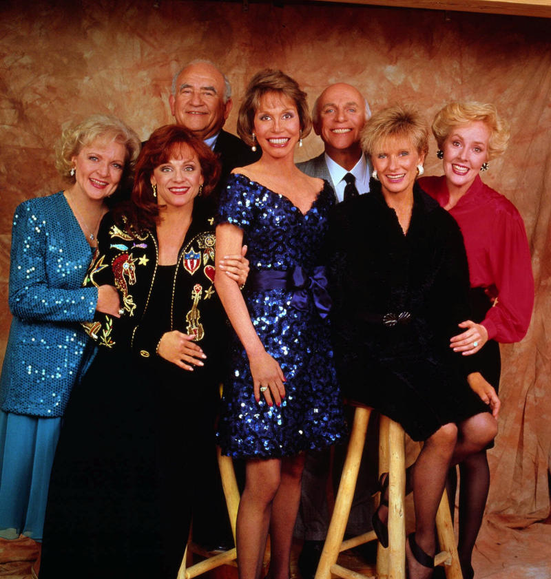 """FILE - This undated handout publicity photo shows, from left, Betty White, Valerie Harper, Ed Asner, Mary Tyler Moore, Gavin MacLeod, Cloris Leachman and Georgia Engel, the original cast of the """"Mary Tyler Moore Show.""""  White reunites with her former co-stars, Mary Tyler Moore, Cloris Leachman, Georgia Engel and Valerie Harper for an upcoming episode of  """"Hot in Cleveland."""" (AP Photo, File)"""