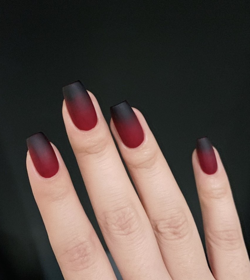 """<p>Simple but effective, try out nail polish entrepreneur Michelle Lin's black-to-red ombre nail design this Halloween. As <a href=""""https://www.youtube.com/watch?v=hwlBobg0djc"""" rel=""""nofollow noopener"""" target=""""_blank"""" data-ylk=""""slk:popular youtube tutorials show"""" class=""""link rapid-noclick-resp"""">popular youtube tutorials show</a>, using a sponge is usually your best bet to achieving this effect. </p><p><a class=""""link rapid-noclick-resp"""" href=""""https://www.amazon.com/Swisspers-Premium-Cosmetic-Wedges-Latex-Free/dp/B005JIXZ64/ref=sr_1_3?tag=syn-yahoo-20&ascsubtag=%5Bartid%7C10072.g.33239588%5Bsrc%7Cyahoo-us"""" rel=""""nofollow noopener"""" target=""""_blank"""" data-ylk=""""slk:SHOP NAIL SPONGE"""">SHOP NAIL SPONGE</a></p>"""