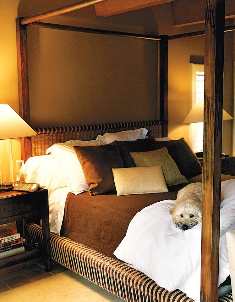 "Josh's pooch Sweeney curls up on the singer's four-poster Ralph Lauren bed. Bobby Fisher/<a href=""http://www.instyle.com/instyle/"" target=""new"">In Style</a> - 2008"