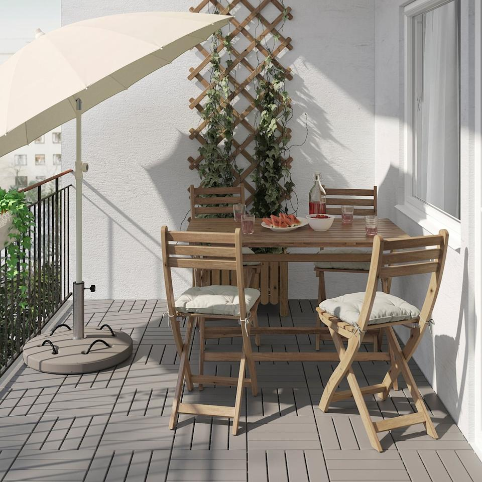 """<p>Enjoy a sit-down dinner outdoors no matter how small your space is with the <a href=""""https://www.popsugar.com/buy/Askholmen-Table-Four-Chairs-580751?p_name=Askholmen%20Table%20and%20Four%20Chairs&retailer=ikea.com&pid=580751&price=129&evar1=casa%3Aus&evar9=46226851&evar98=https%3A%2F%2Fwww.popsugar.com%2Fhome%2Fphoto-gallery%2F46226851%2Fimage%2F47540408%2FAskholmen-Table-Four-Chairs&list1=shopping%2Cfurniture%2Cikea%2Csummer%2Csmall%20space%20living%2Chome%20shopping&prop13=api&pdata=1"""" rel=""""nofollow"""" data-shoppable-link=""""1"""" target=""""_blank"""" class=""""ga-track"""" data-ga-category=""""Related"""" data-ga-label=""""https://www.ikea.com/us/en/p/askholmen-table-and-4-chairs-outdoor-gray-brown-stained-s19212182/"""" data-ga-action=""""In-Line Links"""">Askholmen Table and Four Chairs</a> ($129).</p>"""