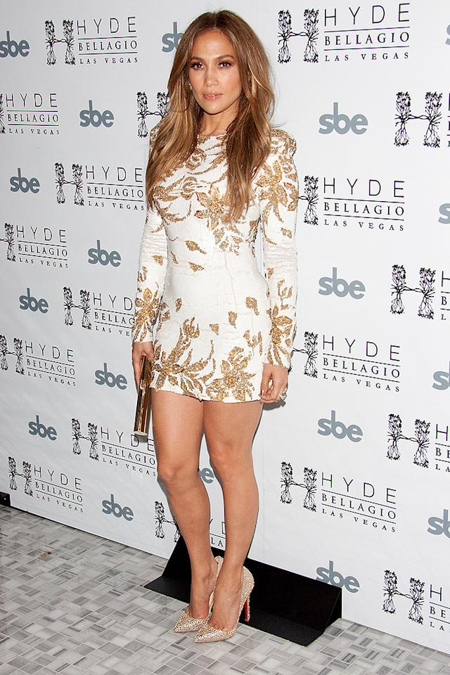 """American Idol's"" latest installment came to a conclusion just last week, but that doesn't mean J.Lo is ready to step out of the spotlight. Over the weekend, she made a special appearance in Sin City to celebrate the launch of her new single, ""Goin' In."" For the occasion, the diva extraordinaire donned a Zuhair Murad mini dress, which featured long sleeves and gold-sequined leaves, along with sparkly Louboutin heels. (5/26/2012)"