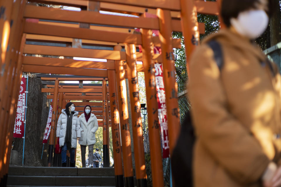 Worshippers visit shrines situated side by side in Tokyo on New Year's Day, Friday, Jan. 1, 2021. (AP Photo/Hiro Komae)