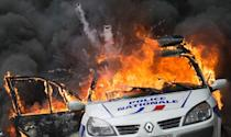 A police patrol car explodes after being set on fire after an unauthorized counter-demonstration against police brutality in Paris on May 18, 2016 (AFP Photo/Cyrielle SICARD)