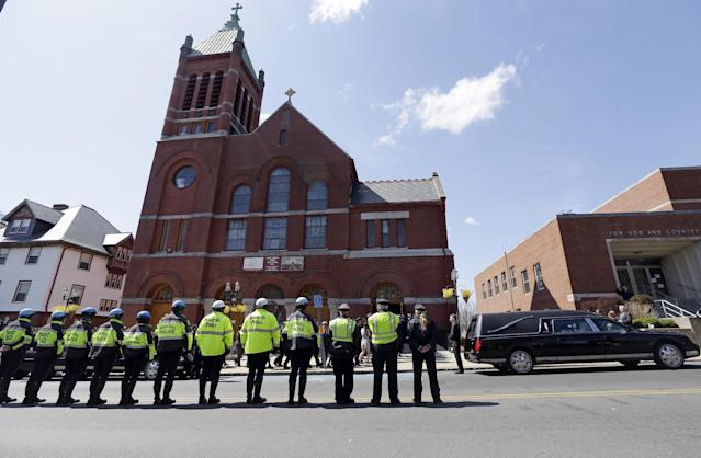 Medford and Somerville police line the street outside St. Joseph's Church in Medford, Mass. Monday, April 22, 2013 for the funeral of Boston Marathon bomb victim Krystle Campbell, 29. (AP Photo/Elise Amendola)