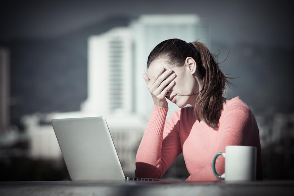 Stressed out businesswoman on her computer.