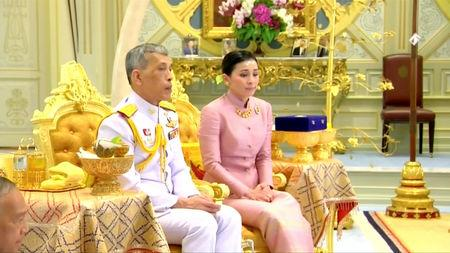 King Maha Vajiralongkorn and his consort, General Suthida Vajiralongkorn named Queen Suthida attend their wedding ceremony in Bangkok, Thailand May 1, 2019, in this screen grab taken from a video. Thai TV Pool