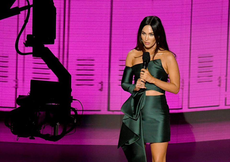 LOS ANGELES, CALIFORNIA - NOVEMBER 22: In this image released on November 22, Megan Fox speaks onstage for the 2020 American Music Awards at Microsoft Theater on November 22, 2020 in Los Angeles, California. (Photo by Kevin Winter/AMA2020/Getty Images for dcp)