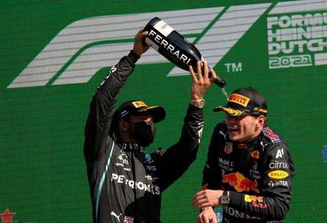 Red Bull driver Max Verstappen, right, replaced Lewis Hamilton on top of the F1 standings