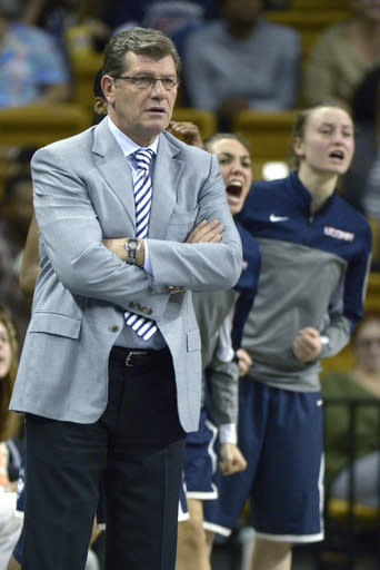 Connecticut head coach Geno Auriemma, left, Briana Pulido, center, Tierney Lawlor react from the sideline after a score during the first half of an NCAA college basketball game against Central Florida in Orlando, Fla., Wednesday, Jan. 1, 2014.(AP Photo/Phelan M. Ebenhack)