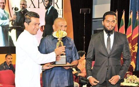 Sri Lankan suicide bomber Inshaf Ahamad, pictured far right alongside his successful businessman father Mohamed Ibrahim in 2016 - Credit: Daily News