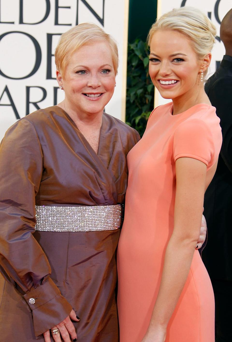 <p>Nominated for Best Performance by an Actress in a Motion Picture — Comedy or Musical for her role in <em>Easy A,</em> Stone brought her mom, Krista Jean, as her date to the Globes. (Photo: Jeff Vespa/WireImage) </p>