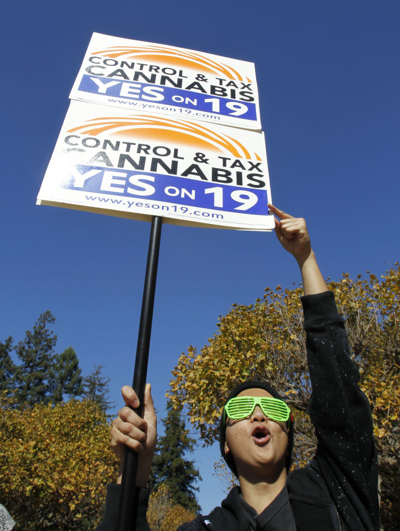 California Proposition 19, the legalization of marijuana initiative, supporter Charles Sinfuego holds up a sign during a rally at Sproul Plaza on the University of California, Berkeley campus in Berkeley, Calif., Monday, Nov. 1, 2010. The rally was sponsored by the Students for Sensible Drug Policy, UC Berkeley Chapter. (AP Photo/Paul Sakuma)