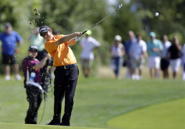 Bryce Molder hits a fairway shot on the 15th hole during the final round of The Barclays golf tournament Sunday, Aug. 25, 2013, in Jersey City, N.J. (AP Photo/Mel Evans)