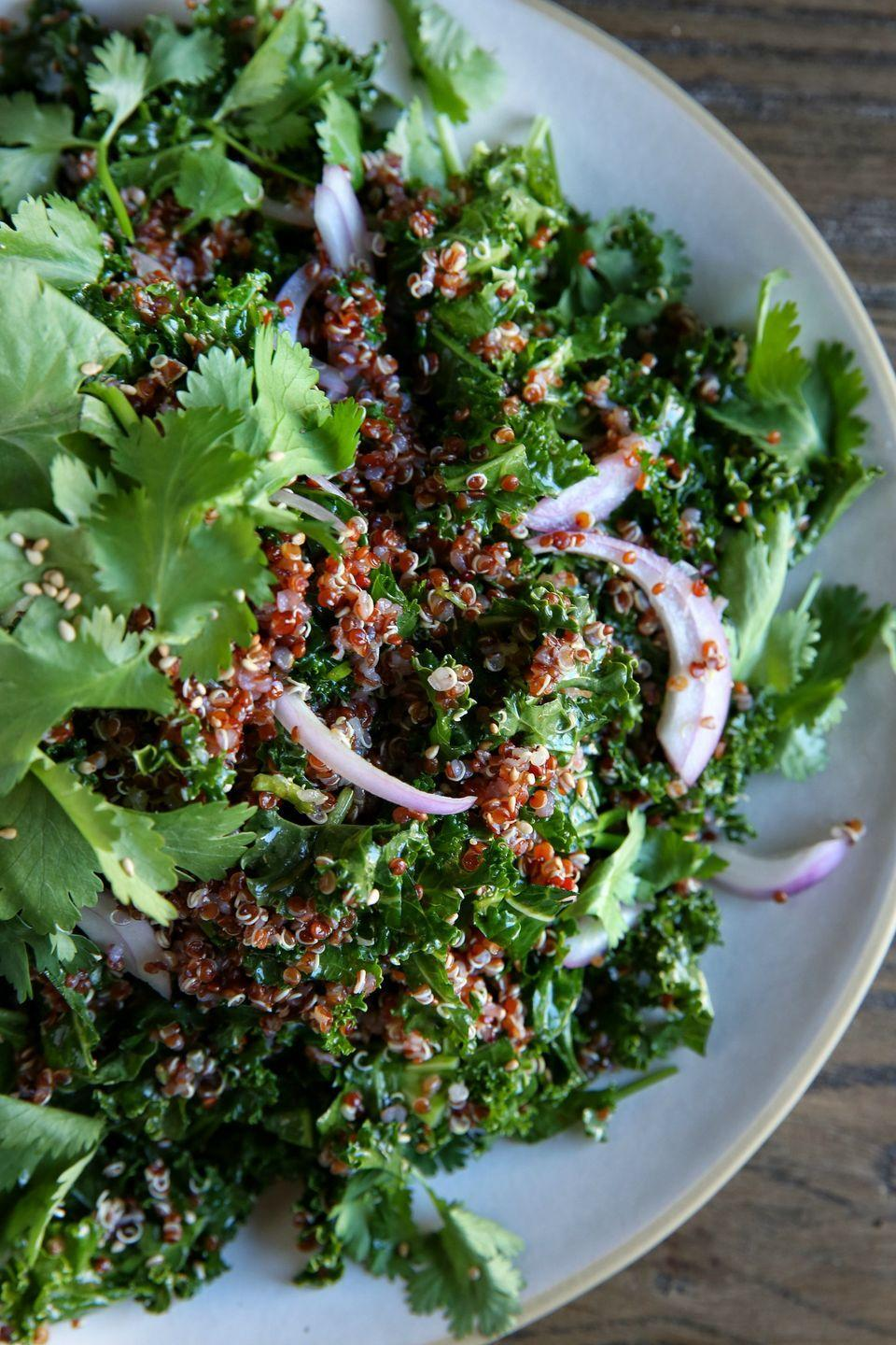"""<p>The addictive dressing on this salad is about to become one of your mainstays.</p><p>Get the recipe from <a href=""""https://www.delish.com/cooking/recipe-ideas/recipes/a46443/kale-and-red-quinoa-salad-with-spicy-sesame-dressing-recipe/"""" rel=""""nofollow noopener"""" target=""""_blank"""" data-ylk=""""slk:Delish"""" class=""""link rapid-noclick-resp"""">Delish</a>.</p>"""