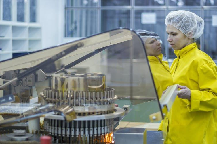 A woman working in a vaccine manufacturing plant.