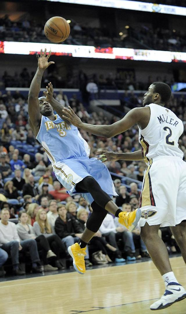 Denver Nuggets guard Ty Lawson (3) shoots over New Orleans Pelicans forward Darius Miller (2) during the first half of an NBA basketball game in New Orleans, Friday, Dec. 27, 2013. (AP Photo/Stacy Revere)