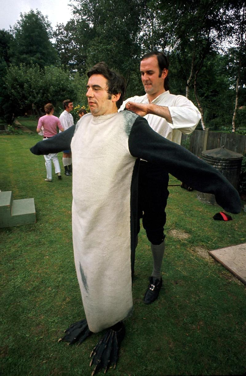 Terry Jones, right, and John Cleese, putting on costumes for a Monty Python's Flying Circus sketch.