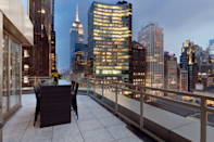 """<p>Designed by noted architect Tony Chi, <a href=""""https://www.cntraveler.com/hotels/united-states/new-york/andaz-5th-avenue--new-york?mbid=synd_yahoo_rss"""" rel=""""nofollow noopener"""" target=""""_blank"""" data-ylk=""""slk:this 5th Avenue hotel"""" class=""""link rapid-noclick-resp"""">this 5th Avenue hotel</a> is located a short walk from city icons like <a href=""""https://www.cntraveler.com/activities/new-york/grand-central-terminal?mbid=synd_yahoo_rss"""" rel=""""nofollow noopener"""" target=""""_blank"""" data-ylk=""""slk:Grand Central Station"""" class=""""link rapid-noclick-resp"""">Grand Central Station</a>, the <a href=""""https://www.cntraveler.com/activities/new-york/empire-state-building?mbid=synd_yahoo_rss"""" rel=""""nofollow noopener"""" target=""""_blank"""" data-ylk=""""slk:Empire State Building"""" class=""""link rapid-noclick-resp"""">Empire State Building</a>, and the main branch of the New York Public Library—the latter two of which can be seen from many of the rooms' oversized windows. To enjoy the views even more, book one of the suites with private outdoor space. The One Bedroom Balcony Suites have step-out balconies overlooking 41st Street (a.k.a. Library Way), while the One Bedroom Terrace Suites have furnished terraces with the same view. Up a couple categories, the 5th Avenue Terrace Suite sleeps up to four guests and has a furnished terrace overlooking the library—lion statues and all. The library and the Empire State Building are the stars of the show on the furnished wrap-around terrace of the Empire Terrace Suite, a two-bedroom, two-bath corner option that also has a living room and kitchenette. </p> <p><strong>Book now</strong>: <a href=""""https://cna.st/affiliate-link/8x79xMVF6j2YqAzJWTFPQt2aP7Uc9WiKmZoTwmEo8f3hupWEKZryeG68RLCDjZryZ3M4yyK8bGc8odxxSJStSXPRzrWHXXKhrDjkMKai2x5tKYLEYQ57CteevB1nZUtcTE2iE1a72x2smSRLcEgj2fJ7Nc1yym3KjWDAHWwFv586sYSZBAD?cid=5ba53e79c4c3254b31283e39"""" rel=""""nofollow noopener"""" target=""""_blank"""" data-ylk=""""slk:From $525 per night, expedia.com"""" class=""""link rapid-noclick-resp"""">From $525 per night, exp"""