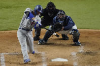 Los Angeles Dodgers' Corey Seager hits a home run against the Tampa Bay Rays during the third inning in Game 4 of the baseball World Series Saturday, Oct. 24, 2020, in Arlington, Texas. (AP Photo/Sue Ogrocki)