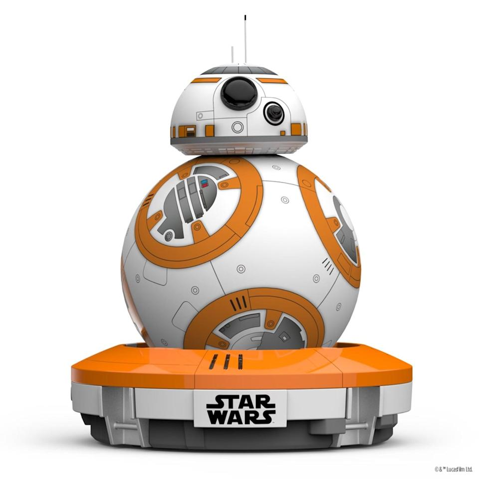 "<p>Any Star Wars fan will love having this <a rel=""nofollow noopener"" href=""https://www.popsugar.com/buy/BB-8%20App-Enabled%20Droid-105165?p_name=BB-8%20App-Enabled%20Droid&retailer=amazon.com&price=62&evar1=moms%3Aus&evar9=45374878&evar98=https%3A%2F%2Fwww.popsugar.com%2Fmoms%2Fphoto-gallery%2F45374878%2Fimage%2F45374920%2FBB-8-App-Enabled-Droid&list1=holiday%2Cgift%20guide%2Cparenting%20gift%20guide%2Cgifts%20for%20kids%2Ckid%20shopping%2Ctweens%20and%20teens%2Cgifts%20for%20teens&prop13=mobile&pdata=1"" target=""_blank"" data-ylk=""slk:BB-8 App-Enabled Droid"" class=""link rapid-noclick-resp"">BB-8 App-Enabled Droid</a> ($62, originally $150) by their side.</p>"