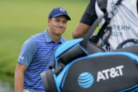 Jordan Spieth smiles after he eagles from the rough on the sixth green to complete his second consecutive eagle for the day in the second round at the Northern Trust golf tournament, Friday, Aug. 20, 2021, at Liberty National Golf Course in Jersey City, N.J. (AP Photo/John Minchillo)
