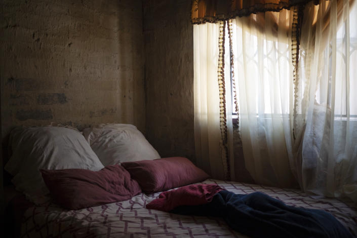 The bed that Amanda Zitho shared with her 5-year-old son Wandi is seen in their house in Orange Farm, South Africa, on Aug. 26, 2020. The boy was murdered in a suspected witchcraft ritual and his body was found in his neighbor's tavern. (AP Photo/Bram Janssen)