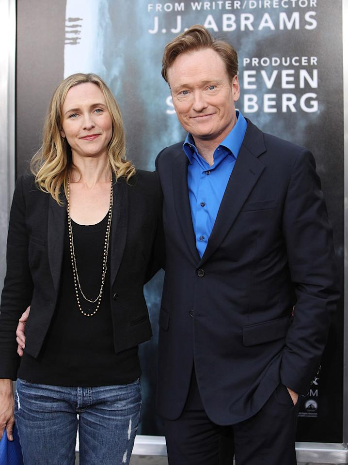 "Conan O'Brien and guest at the Los Angeles premiere of <a href=""http://movies.yahoo.com/movie/1800063512/info"">Super 8</a> on June 8, 2011."