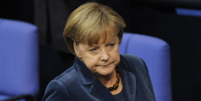 German Chancellor Angela Merkel  reacts  during a debate at  the German federal parliament, Bundestag,  in Berlin, Germany, Wednesday, Oct. 26, 2011. Merkel  is calling for the private sector to make a significantly larger contribution than previously agreed to reduce Greece's debt burden.  Merkel  said the aim of a European summit Wednesday must be a solution that allows for Greece to cut its debt load to 120 percent of gross domestic product by 2020. (AP Photo/dapd/Michael Gottschalk)