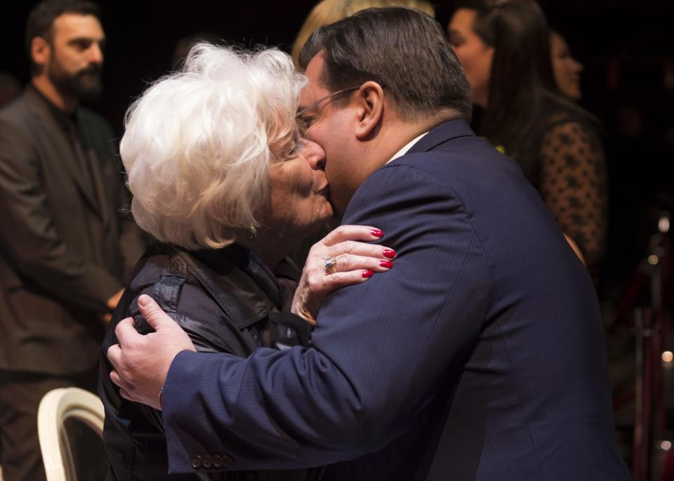 Montreal mayor Denis Coderre offers his condolences to Elise Beliveau, wife of Montreal Canadiens legend Jean Beliveau during the public viewing for the Montreal Canadiens legend Jean Beliveau Sunday, Dec. 7, 2014, in Montreal. (AP Photo/The Canadian Press, Paul Chiasson)