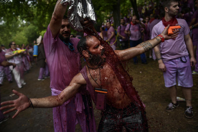 <p>A reveler is covered in wine as people take part in a wine battle, in the small village of Haro, northern Spain, Friday, June 29, 2018. (Photo: Alvaro Barrientos/AP) </p>