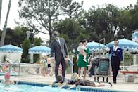 """<p><strong>""""Tomorrowland"""" (2010)</strong><br><br>Ad exec Don Draper made regular trips from NYC to California, but in the final <em>Mad Men</em> episode before that excruciating 17-month hiatus over contract negotiations, he segued his business with old friend Anna Draper into a Disneyland vacation with his kids — and secretary, Megan Calvet. This cross-country trek was a life-changer for Draper, who was so mesmerized by Megan's nurturing poolside manner with his young children that he surprised everyone — including himself — by proposing to her.<br><br>(Photo: Mike Yarish /AMC / Courtesy: Everett Collection) </p>"""