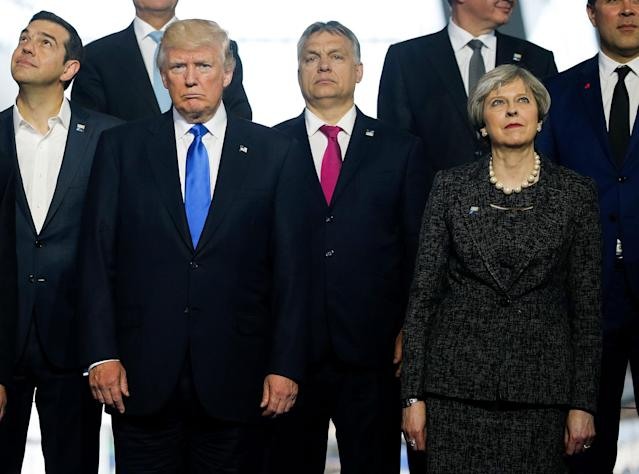 <p>(L-R) Greek Prime Minister Alexis Tsipras, U.S. President Donald Trump, Hungarian Prime Minister Voktor Orban and Britain's Prime Minister Theresa May pose during a family photo at the start of NATO summit at their new headquarters in Brussels, Belgium, May 25, 2017. (Photo: Jonathan Ernst/Reuters </p>