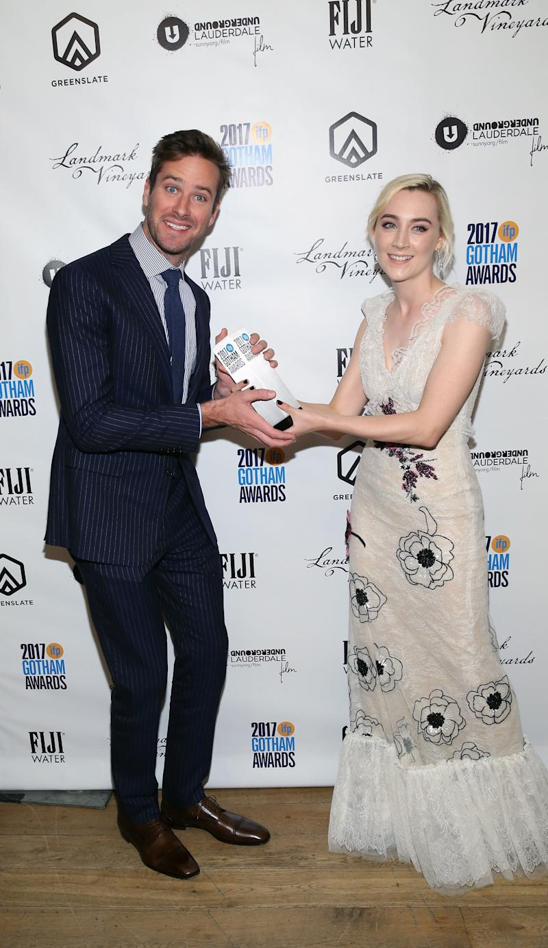 NEW YORK, NY - NOVEMBER 27: Armie Hammer and Saoirse Ronan poses with her award at the 2017 Gotham Awards sponsored by Greater Ft. Lauderdale Tourism at Cipriani, Wall Street on November 27, 2017 in New York City. (Photo by Bennett Raglin/Getty Images for Greater Fort Lauderdale Convention & Visitors Bureau)