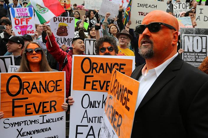 """<p>Demonstrators painted orange gather at a """"Not My President's Day"""" rally in Los Angeles, Feb. 20, 2017. (Photo: David McNew/Reuters) </p>"""