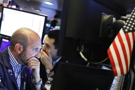 Traders work on the floor of the New York Stock Exchange shortly after the closing bell in New York