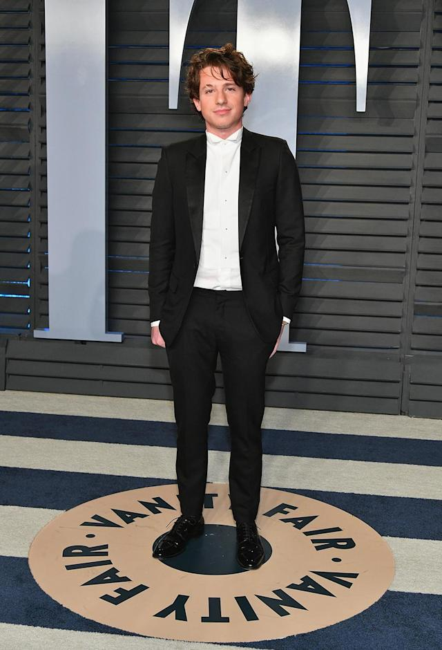 <p>No tie? No problem. Singer Charlie Puth made his own style rules at the <em>Vanity Fair</em> party. (Photo: Dia Dipasupil/Getty Images) </p>