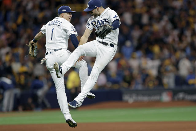 Tampa Bay Rays shortstop Willy Adames (1) and center fielder Kevin Kiermaier celebrate the team's 4-1 win over the Houston Astros in Game 4 of a baseball American League Division Series, Tuesday, Oct. 8, 2019, in St. Petersburg, Fla. (AP Photo/Chris O'Meara)