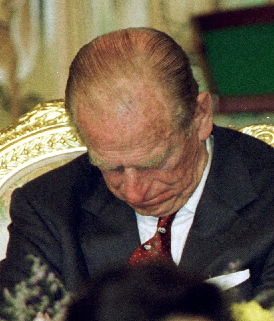 <p>The Duke of Edinburgh resting his eyes during speeches at the state banquet held in honour of Queen Elizabeth II during her state visit to South Korea. (Photo credit: Chris Ison   PA Archive/PA Images) </p>