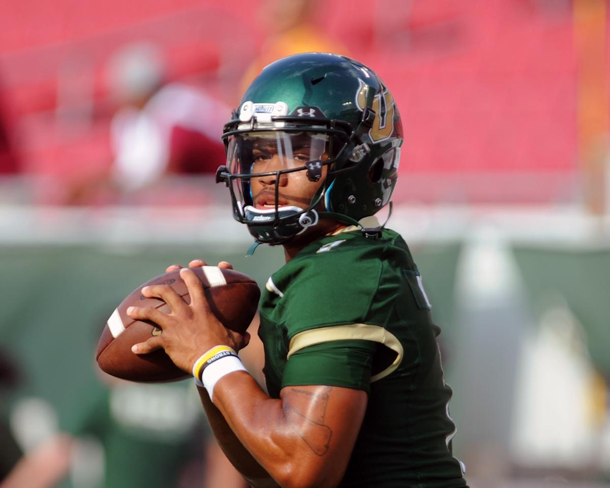 TAMPA, FL - SEPTEMBER 29:  Quarterback B. J. Daniels #7 of the South Florida Bulls warms up for play against the Florida State Seminoles September 29, 2012 at Raymond James Stadium in Tampa, Florida. ( Photo by Al Messerschmidt/Getty Images)