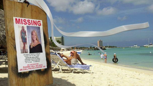 PHOTO: This June 10, 2005 file photo shows a missing poster for Natalee Holloway, a high school graduate of Mountain Brook, Ala., who disappeared while on a graduation trip to Aruba on May 30, 2005. (Leslie Mazoch/AP, FILE)
