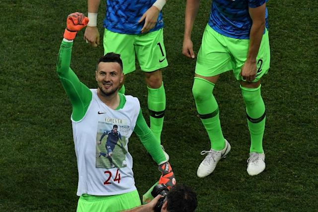 Croatia goalkeeper Danijel Subasic celebrates his team's World Cup victory against Denmark, wearing a T-shirt bearing the image of a former team-mate, who died from injuries sustained during a match (AFP Photo/Martin BERNETTI)