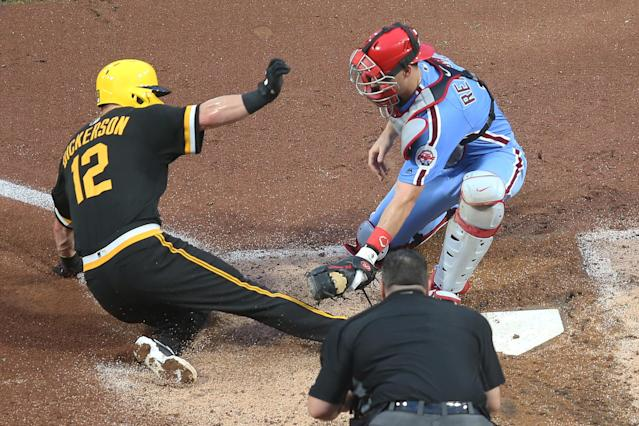 Jul 20, 2019; Pittsburgh, PA, USA; Philadelphia Phillies catcher J.T. Realmuto (10) tags Pittsburgh Pirates left fielder Corey Dickerson (12) out at home plate attempting to score during the fourth inning at PNC Park. Mandatory Credit: Charles LeClaire-USA TODAY Sports