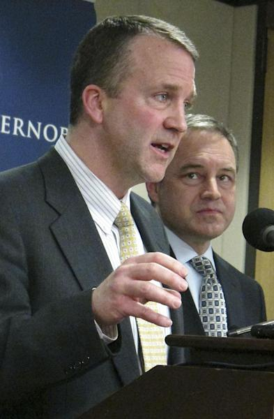 Natural Resources Commissioner Dan Sullivan, left, and Alaska Gov. Sean Parnell appear at a news conference Friday, March 30, 2012, in Anchorage, Alaska, confirming that a settlement over disputes on leases in the Point Thomson gas fields had been reached with Exxon Mobil Corp., BP PLC and ConocoPhillips. (AP Photo/Mark Thiessen)