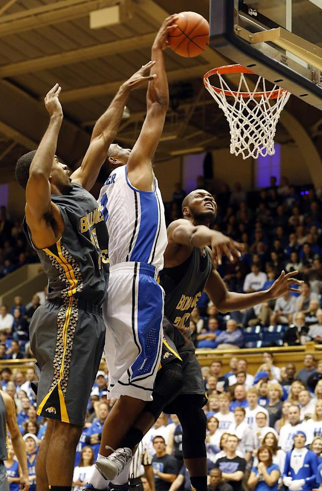Duke's Jabari Parker (1) splits the defense of Bowie State's Brian Freeman, left and Carlos Smith, right, during the first half of an exhibition NCAA college basketball game in Durham, N.C., Saturday, Oct. 26, 2013. (AP Photo/Karl B. DeBlaker)