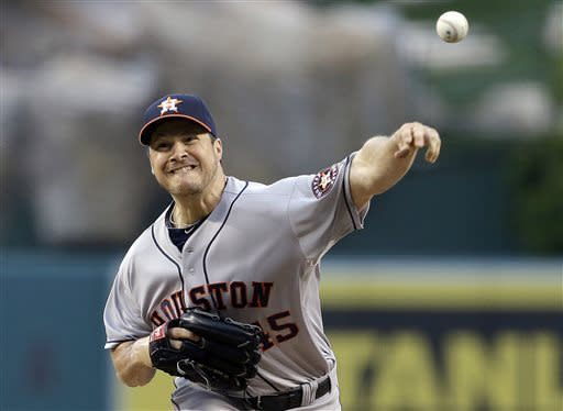 Houston Astros starter Erik Bedard pitches to the Los Angeles Angels in the first inning of a baseball game in Anaheim, Calif., Monday, June 3, 2013. (AP Photo/Reed Saxon)