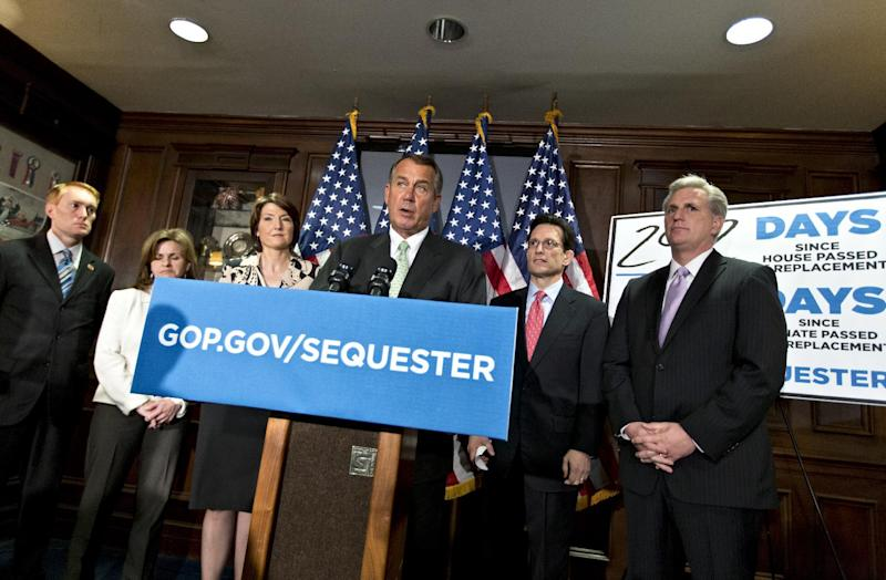 "Following a closed-door party caucus, House Speaker John Boehner of Ohio, center, and GOP leaders meet with reporters, on Capitol Hill in Washington, Tuesday, Feb. 26 2013, to challenge President Obama and the Senate to avoid the automatic spending cuts that take effect in four day. Speaking at the Republican National Committee headquarters, Boehner complained that the House, with Republicans in the majority, has twice passed bills that would replace the across-the-board cuts known as the ""sequester"" with more targeted reductions, while the Senate, controlled by the Democrats, has not acted. A frustrated Boehner told reporters, quote, ""We should not have to move a third bill before the Senate gets off their ass and begins to do something."" From left are, Rep. James Lankford, R-Okla., Rep. Lynn Jenkins, R-Kansas, Rep. Cathy McMorris Rodgers, R-Wash., Boehner, House Majority Leader Eric Cantor of Va. and House Majority Whip Kevin McCarthy of Calif. (AP Photo/J. Scott Applewhite)"