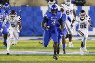 Kentucky defensive end Joshua Paschal (4) runs 77 yards after intercepting a Mississippi State pass during the first half of an NCAA college football game, Saturday, Oct. 10, 2020, in Lexington, Ky. (AP Photo/Bryan Woolston)