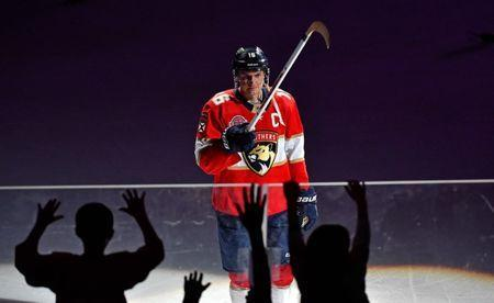 Mar 8, 2019; Sunrise, FL, USA; Florida Panthers center Aleksander Barkov (16) gives his hockey stick to some fans after the game against the Minnesota Wild at BB&T Center. Mandatory Credit: Steve Mitchell-USA TODAY Sports