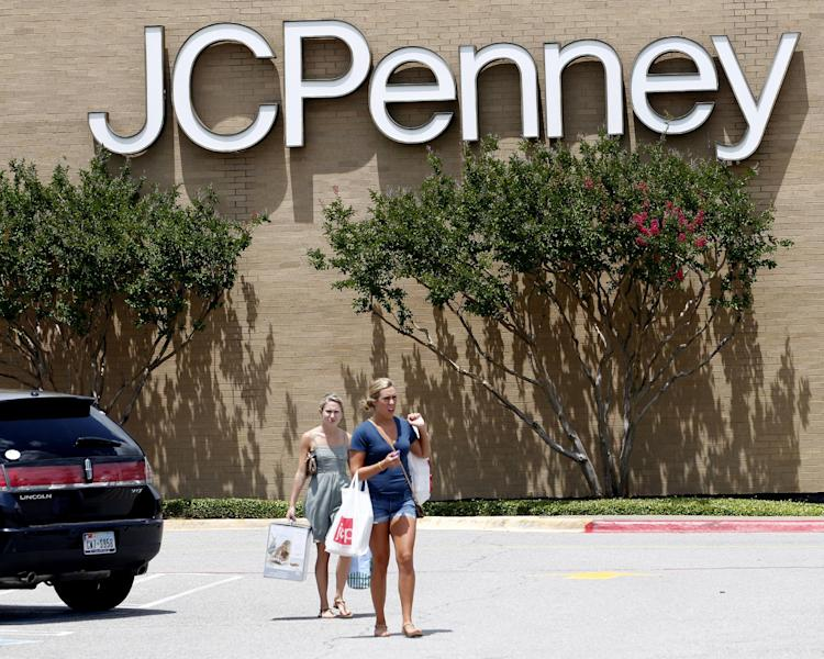 FILE - Shoppers walk in a parking lot outside of a JC Penney story in Plano, Texas, in this June 19, 2012 file photo. J.C. Penney Co. is reporting a bigger-than-expected loss and plummeting sales, as its customers continue to be turned off by a new pricing plan that gets rid of hundreds of sales in favor of every day lower prices. (AP Photo/LM Otero, File)